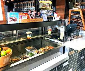 Stop by the Barrel and Bushel's Market! We have freshly made to-go items and Illy Coffee.